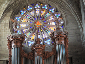 The rose window of the Cathedral of Beziers rises above the church's beautiful organ. Photo By Bill Reed