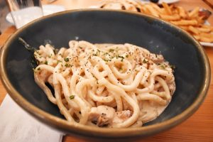 Cacio e pepe, a thicker bucatini pasta coated in a parmesan and cracked black pepper sauce ($17).