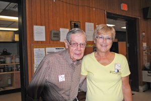 Debby Allen is president of Fulton Shirts 'N Skirts. Next to her is a one of the club's member, Walt Hobble, who is 92.