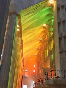 Depending on the time of day, the interior of the Basilica of the Sagrada Familia ripples with blue, green and red light from its massive stained-glass windows.