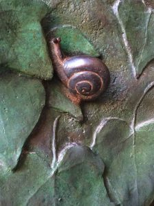 For all its grandeur, the Sagrada Familia also features tiny details that reflect its architect's love of nature, like this little snail nestled in the leaves that cover the massive bronze doors.