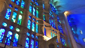 Sagrada Familia in Barcelona seems like an underwater paradise, with the light from massive stained-glass windows rippling through the church.