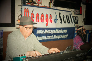 "Michael Davis playing his organ for a recent club date with band ""Ménage A Soul."""