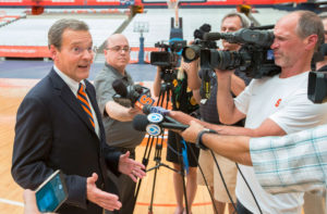 John Wildhack talking to the press in 2016 during his introduction as athletics director at Syracuse University. Photo courtesy of Syracuse University Athletics.
