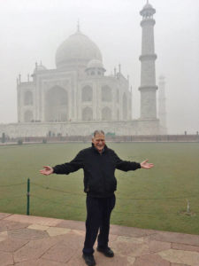 Marvin Druger in front of the Taj Mahal covered in morning fog.
