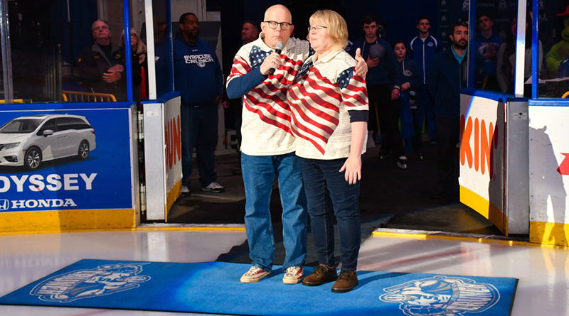 Chuck and Betsy Copps sing the National Anthem before a Syracuse Crunch hockey game. Courtesy of Scott Thomas Photography.