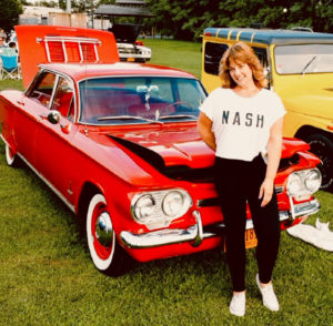 Eastwood resident Amy Bamerick next to the car of her dreams: a four-door Chevy Corvair Monza 900 model, known as Miss Daisy.