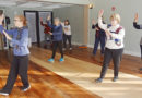 Genoa Wilson (left) leads her students in tai chi at the Manlius Senior Center.