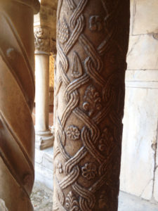 Fanciful carvings top the marble columns at Elne Cathedral's cloister.