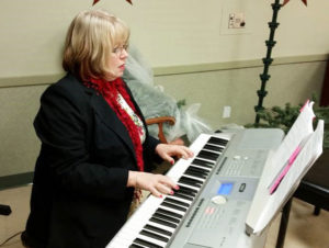 Betsy Copps plays keyboards during a church event. Photo submitted.