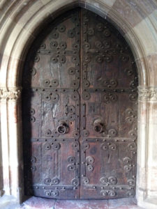 A door at Elne Cathedral is bordered by the pink marble the area is known for.