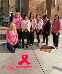 Gupta joins her cancer services program staff this past October during a Breast Cancer Awareness Month event where stencils were painted in many areas throughout Onondaga County promoting mammograms for early detection of breast cancer. Photo provided.