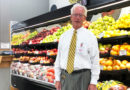 """Mike Hennigan, owner of Nichols Supermarket in the heart of Liverpool. """"I've worked pretty much every job in the store,'' Hennigan says. """"I used to be able to operate every piece of equipment.'' Photo by Margaret McCormick"""