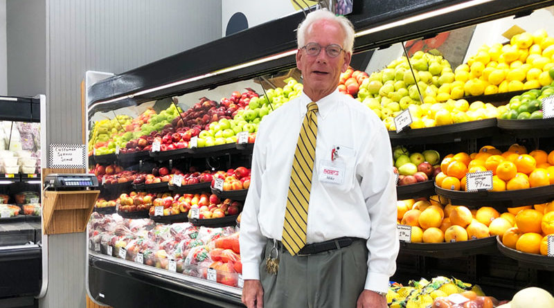 "Mike Hennigan, owner of Nichols Supermarket in the heart of Liverpool. ""I've worked pretty much every job in the store,'' Hennigan says. ""I used to be able to operate every piece of equipment.'' Photo by Margaret McCormick"