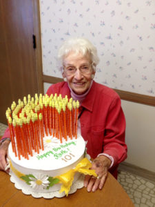 Colvin celebrating her 101st birthday two years ago. She maintains her physical health by walking 2,000 steps — she uses a cane for stability — and playing nine holes of golf every week.