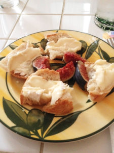 A plate of baguette slices spread with creamy cheese and accompanied by fresh figs, is one of our everyday lunches in France.