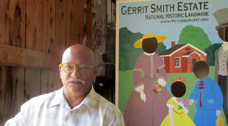 Max Smith inside the barn at the Gerrit Smith Estate in Peterboro; the estate is part of the National Historic Site that tells the story of abolitionist work during the 1800s. Photo by Debra J. Groom.