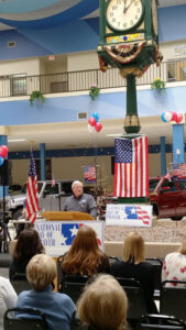 Roger Burdick hosting the annual National Day of Prayer service in Center Court of Driver's Village. Photo provided