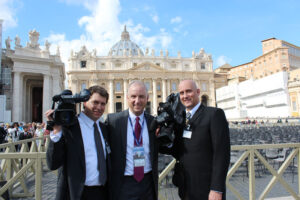 October 2012. Photographer Andy Wolf, Matt Mulcahy and photographer Dave Fulkerson–– in St. Peter's Square, Vatican City cover the canonization of Mother Marianne Cope.