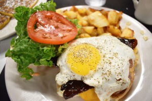 Breakfast burger with home fries at Mother's Cupboard: It is insane.