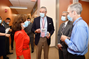 New York Lt. Gov. Kathy Hochul, left, gets briefed on SUNY Upstate Medical University's aggressive approach in combating COVID-19, by right, Frank Middleton, PhD; SUNY Upstate Medical University President Mantosh Dewan, MD; and Stephen Thomas, MD. Thomas, Upstate's chief of infectious disease, serves as lead principal investigator for the Pfizer/BioNTech global phase 3 COVID-19 vaccine trial. Middleton is a co-developer of the Clarifi COVID-19 Test Kit, a saliva swab COVID-19 diagnostic test.  The saliva swab diagnostic test is used widely throughout the SUNY system for testing students for COVID-19.
