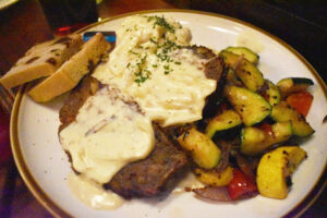 Meatloaf covered with cabbage cream sauce.