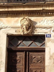 A neighbor's home bears a head of Ceres, the Roman goddess of the harvest.