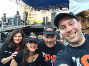 Mimi Griswold and the TK99 crew at a Taste of Syracuse concert event in downtown Syracuse. Photo provided
