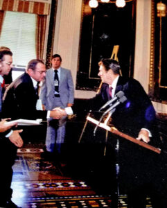 Meeting President Reagan: President Ronald Reagan shakes hands with 55 Plus senior columnist Bruce Frassinelli after a White House news conference in 1981.