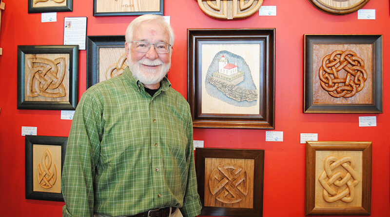 """Carl Patrick, Oswego resident former director of nuclear communications for the New York Power Authority. """"I wish I had known before I retired how many really interesting things there are to do,"""" he says. He is shown with his artwork, which is available at Riverside Artisans, an art co-operative in Oswego."""