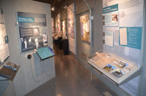 """Display at Safe Haven Holocaust Refugee Shelter Museum in Oswego. The site chronicles the housing of 982 World War II refugees at Fort Ontario as President Roosevelt's """"guests"""" from August 1944 until February 1946.  Photo courtesy of David Granoff."""