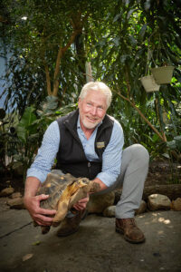 Longtime Affinity for Animals Ted Fox's love of animals dates back to his youth, growing up in Ithaca. His father, Francis, was a veterinarian, and taught large-animal medicine at Cornell University.  He is shown with Mortoise, a 33-year-old radiated tortoise, a critically endangered species native to the island of Madagascar.