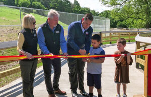 Ted Fox with Onondaga County Executive Ryan McMahon and former Friends of the Zoo President Janet Agostini at the ribbon-cutting for the zoo's new Wildlife Trail walkway in 2019. Photo provided.
