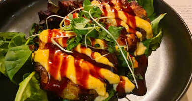 Hearty crab cakes at Kaisai sit on a bed of greens dressed in eel sauce and Ssamjang (spicy Korean paste) aioli.