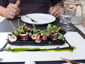 Grilled octopus on a restaurant terrace in Barcelona. (2019)