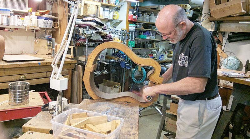 Musician and luthier Mark Wahl bending wood for a guitar he's building.