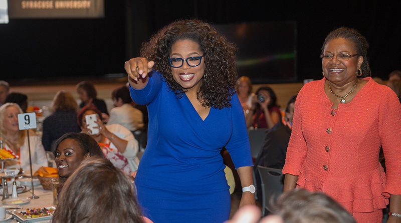 Dean Lorraine Branham and Oprah Winfrey visit with guests at a luncheon to celebrate the dedication of the Newhouse Studio and Innovation Center in September 2014. Winfrey was the featured speaker at the luncheon.