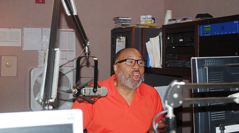 George Kilpatrick at the booth at IHeartRadio in Syracuse during a recent broadcast of his radio program.