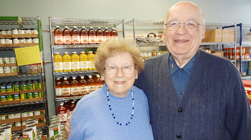 Sue and Ernie Wass at Temple Concord's food pantry. In their 16 years with the organization, the North Syracuse couple has been able to grow the pantry to a larger, more comprehensive operation.