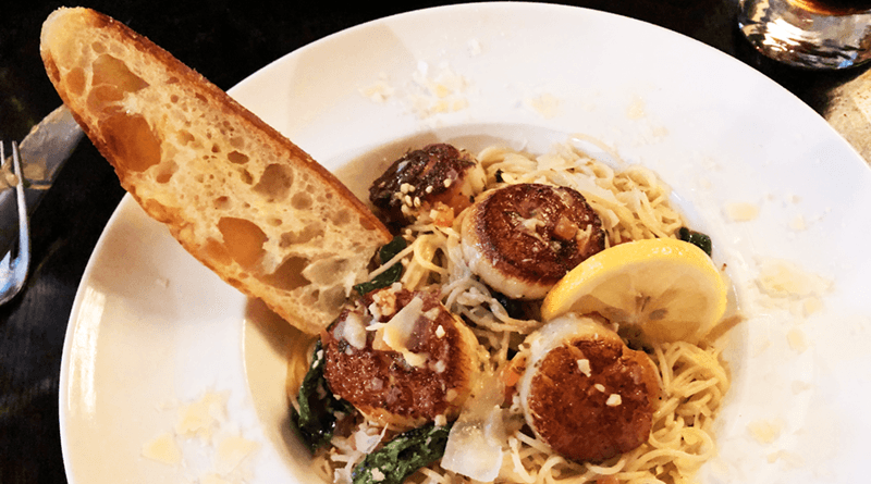 Scallops scampi style over angel hair pasta special.
