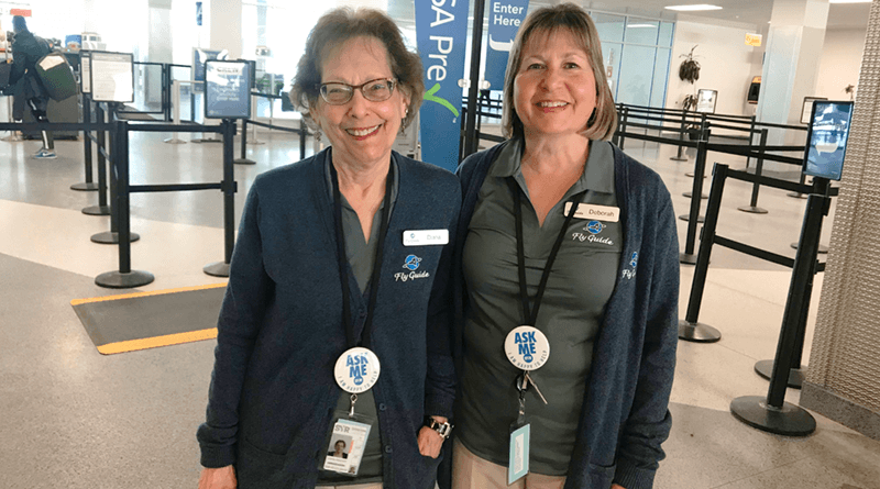 Diana Wolpert (left) and Debbie Trepanier volunteer at Syracuse Hancock International Airport as fly guide ambassadors.