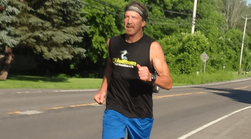 Mike Samoraj running on the streets of Baldwinsville as he prepares for the Lake Placide Ironman.