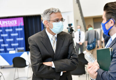 SUNY Upstate Medical University President Mantosh Dewan, MD, speaks with SUNY Chancellor Jim Malatras, right, during one of the chancellor's visits to the Upstate campus last fall. Photo provided