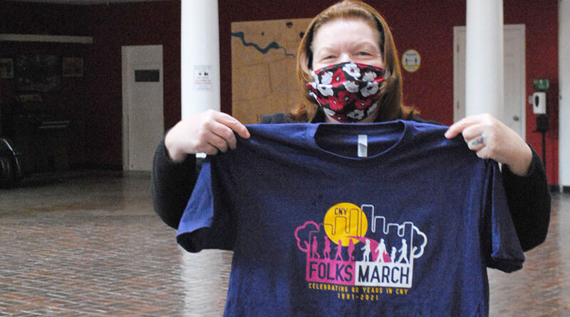 CNY Folksmarch's vice president Sue Straub shows off the group's new T-shirt.